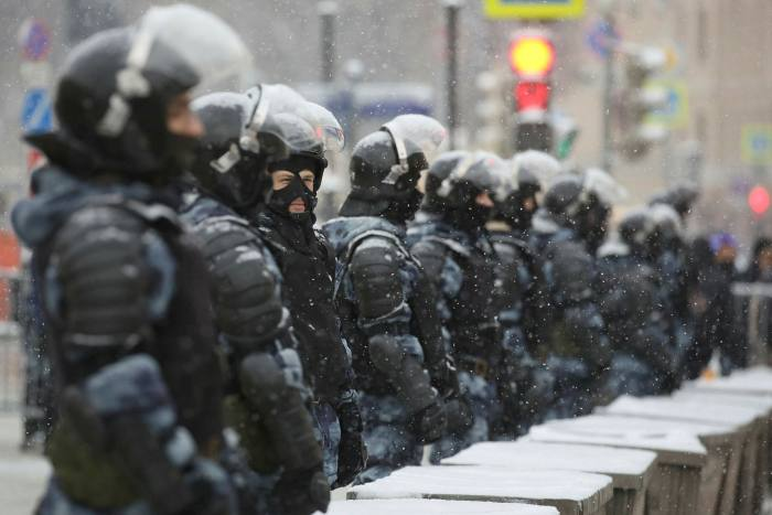 Riot police form a barricade in Moscow. Protesters also rallied in cities and small towns thousands of miles from the capital