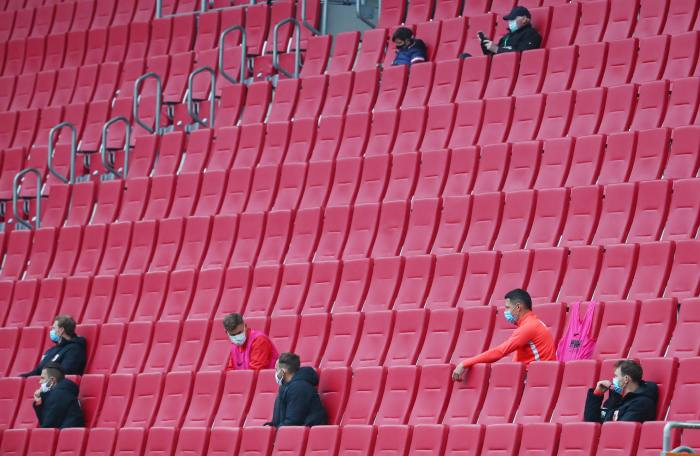 FC Augsburg substitutes remain socially distanced as they sit in the stands during the Bundesliga game against Cologne last month. Under new temporary laws, five subs can be introduced during a match, up from three