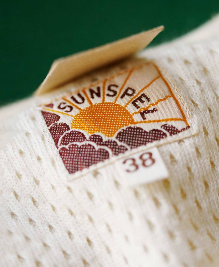 Sunspel's 1950s logo of the sun breaking through the clouds