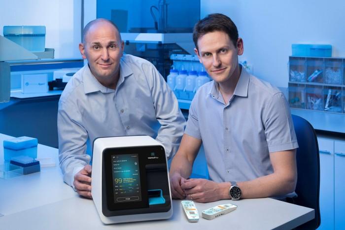 MeMed cofounders Eran Eden (right) and Kfir Oved with their MeMed BV testing kit