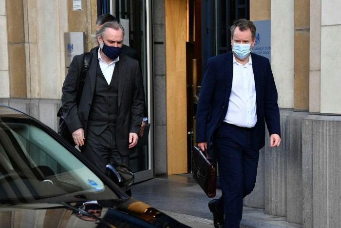 Lord Frost, right, and Tim Barrow, the UK's permanent representative to the EU, leave the British Consulate in Brussels last week
