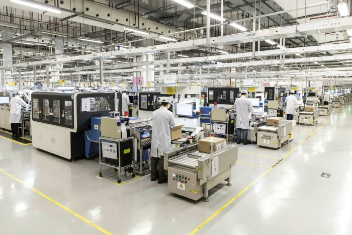 A Huawei smartphone factory in 2019. The company's phone sales have plummeted by 47 per cent in a year and it is projectedto lose up to $40bn of its $50bn business