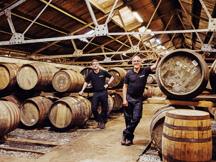 Senior operator Alan Duff Sr(right) with his son Alan Duff Jr, one of Glenmorangie distillery's warehouse team leaders