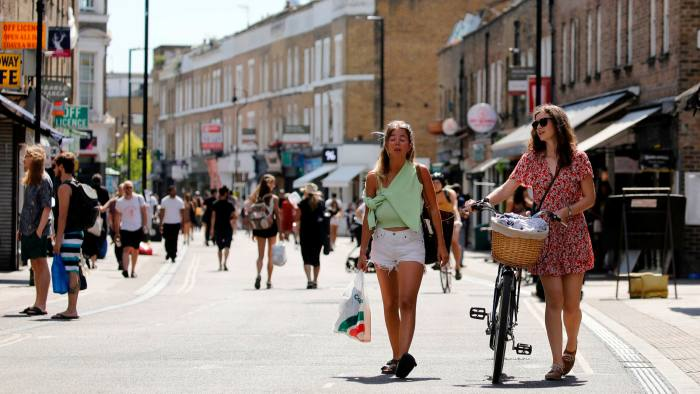 People get out in the sunshine in broadway market, Hackney, north east London on May 20, 2020