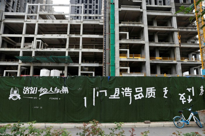A housing complex developed by Evergrande sits unfinished in Luoyang