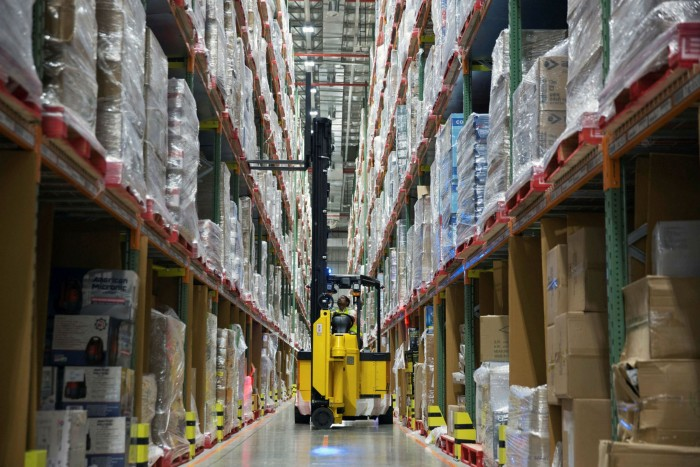 An Amazon warehouse worker in Bengaluru in India. The company has recruited more than 500,000 workers since the coronavirus pandemic began