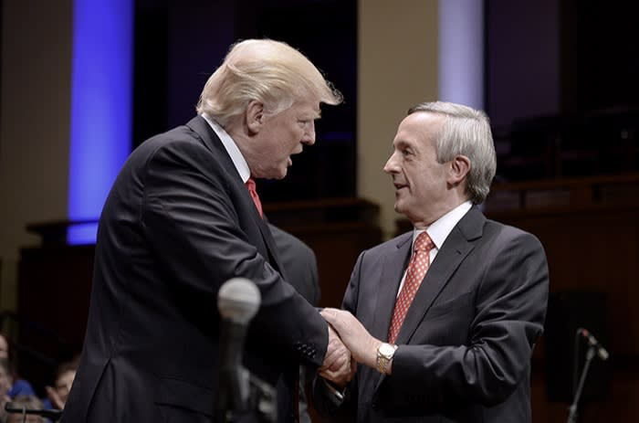 Trump greeting RobertJeffress of First Baptist Dallas church at a rally in 2017; the pastor is a longtime supporter of the president and gave the sermon at his inauguration