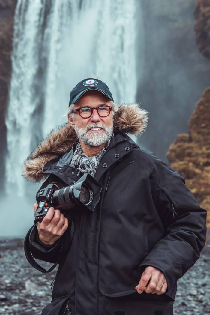 Ragnar Axelsson at Skogafoss waterfall, Iceland, 2019