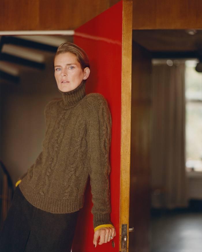 Stella Tennant wears Holland & Holland cashmere jumper, £750,and woolskirt,£590