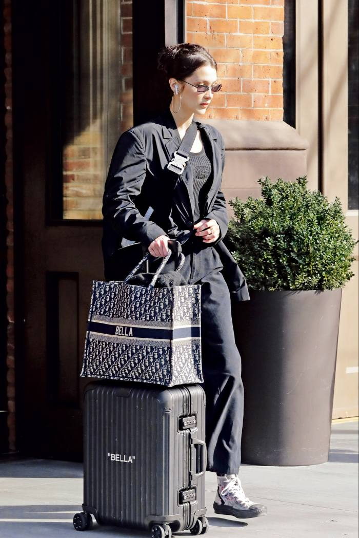 Bella Hadid with her personalised Rimowa x Off-White case