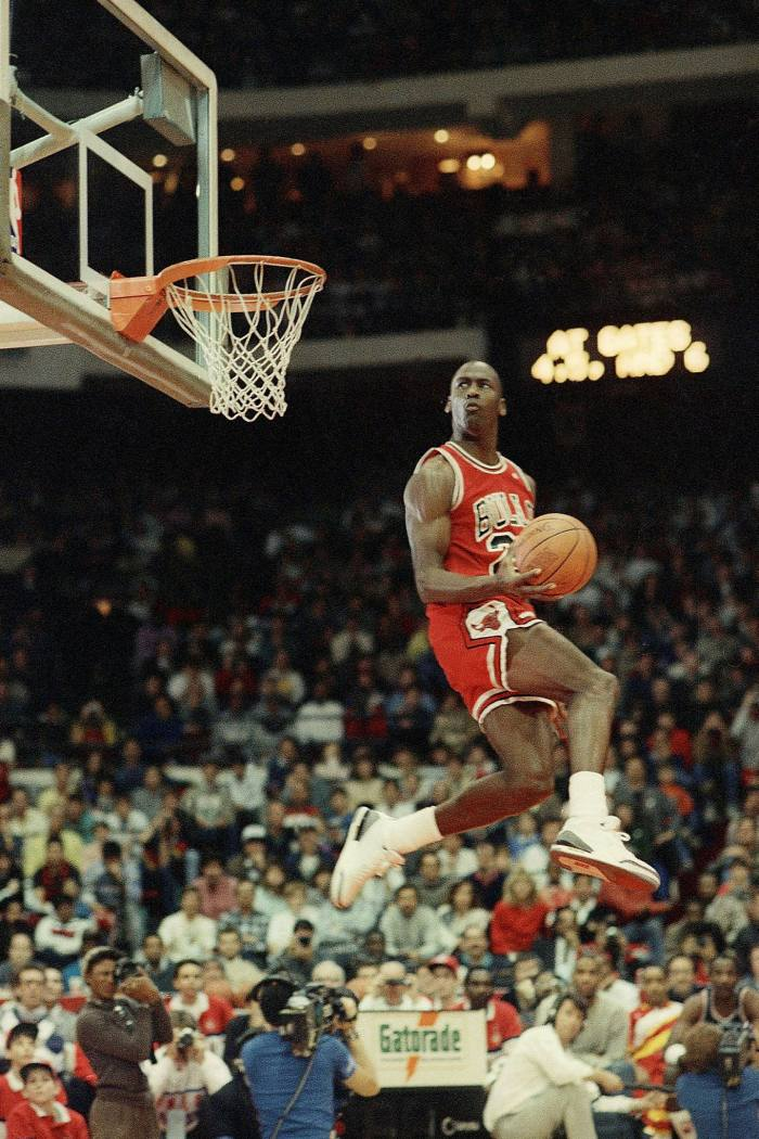 Chicago Bulls' Michael Jordan dunks the ball. The team's former star has bought a stake in aXiomatic, which holds a variety of esports investments