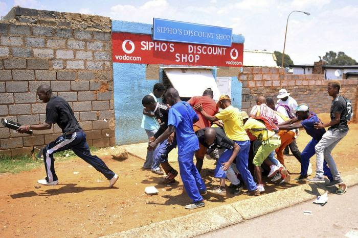 Looters make off with goods from a store in Soweto