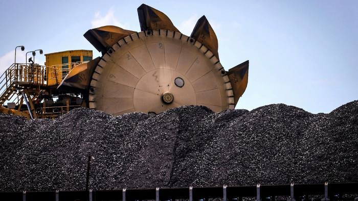 A bucket-wheel reclaimer next to a pile of coal at the Port of Newcastle in Australia