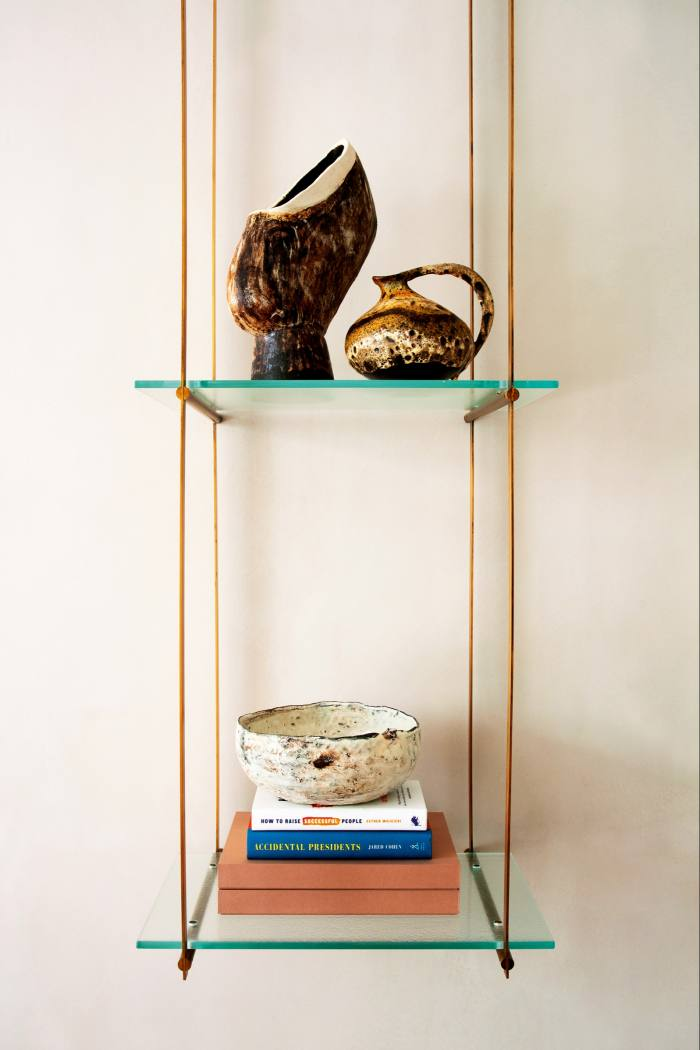 Vintage pieces on the top shelf and a Maud & Mabel bowl and favourite books on the bottom