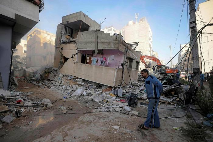 A man walks past a dilapidated building in a badly damaged residential area of Gaza City on Sunday.
