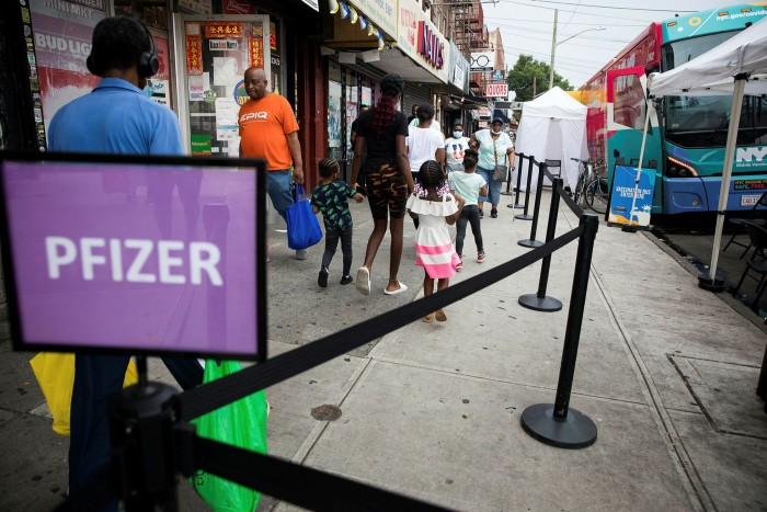 New Yorkers enter a mobile Covid-19 vaccine site in the East Flatbush neighbourhood of Brooklyn