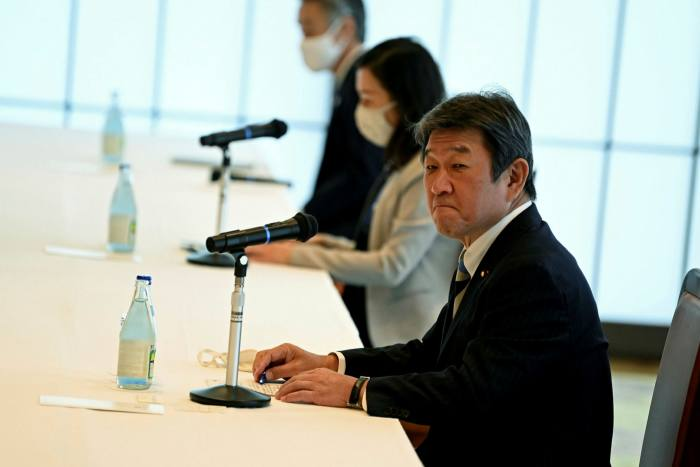 The deal agreed with the UK allowed Japan's foreign minister Toshimitsu Motegi, right, to declare there were 'no new quotas'