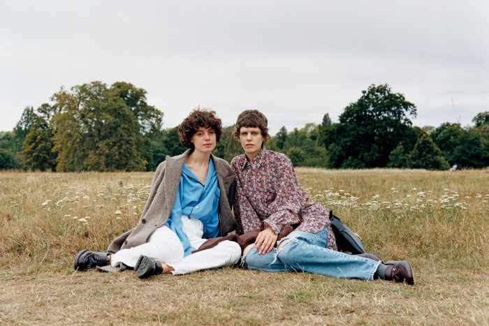 Sarah Lynch-Jones, left, artist, wears Brioni alpaca-wool coat, £5,050, silk pyjama shirt, £1,360, and jeans, £540. Manolo calfskin Umara lace-up shoes, £695. India Grove, right, model and dancer, wears Gucci cotton poplin shirt, £800, jeans, £500, wool jumper (on lap), £700, leather moccasins, £610, and leather medium Jackie bag, £1,590. Socks, model's own