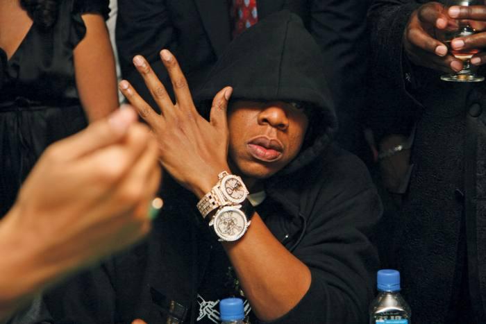 Jay-Z wears Jacob & Co rose-gold and diamond tourbillon, $95,000, and diamond skull watch, $59,750
