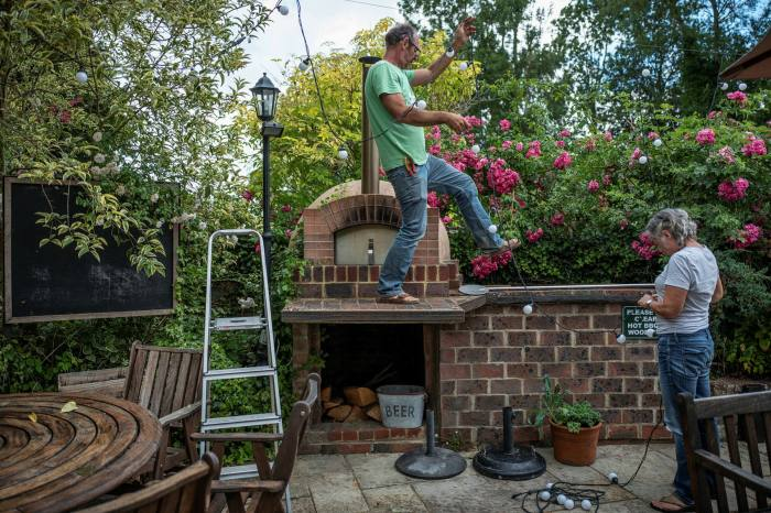 Neighbours lend a hand in the garden to get the Griffin ready for reopening