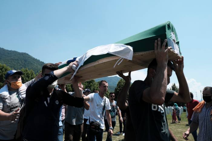 One of nine victims of the 1995 massacre is interred at the Srebrenica Memorial Center on the 25th anniversary of the genocide this July. Victims newly identified from mass graves are buried at the memorial service each year