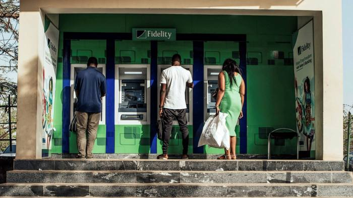 Customers at a retail bank in Abuja