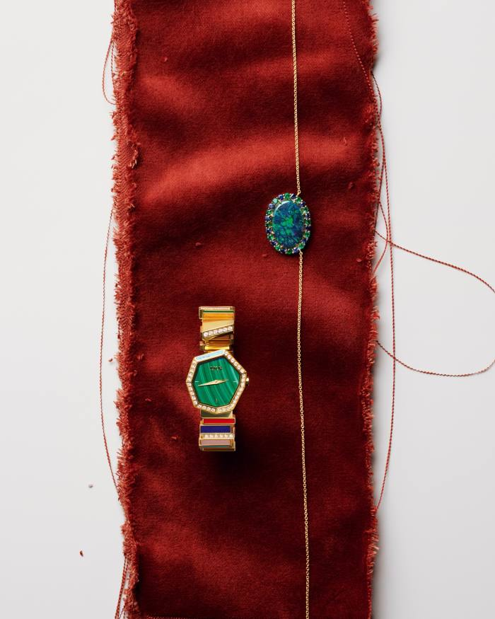 Hirsh gold, Australian black-opal, emerald and sapphire Mother Earth pendant, POA. Dior Watches gold,diamond, lapis lazuli,cornaline, tiger's eye, turquoise and pink-mother-of-pearl GemDior watch, POA