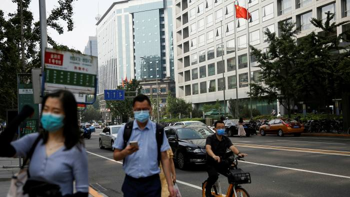 The China Securities Regulatory Commission building in Beijing. The regulator is taking control of two securities brokers, including Guosen Securities