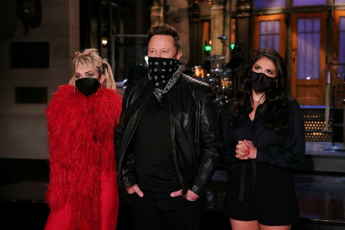 Tesla CEO Elon Musk is centered, with singer Miley Cyrus, and