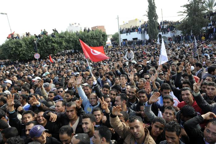 A crowd gathers at a square in Sidi Bouzid, Tunisia, in December 2011, named after Mohamed Bouazizi, to commemorate the one-year anniversary of his death