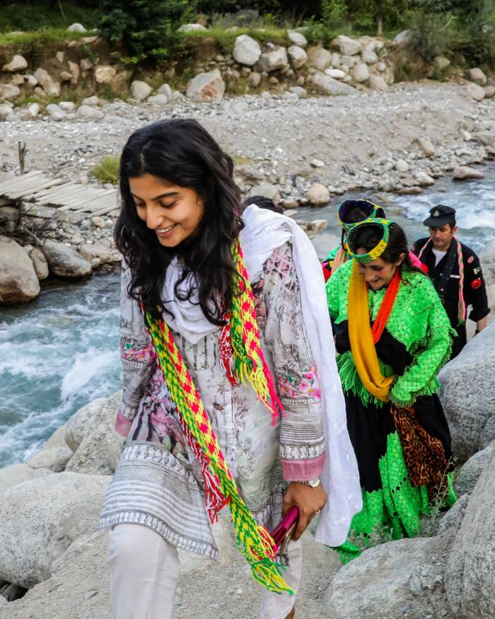 Laila Rajani walks in the Chitral District's Ramboor Valley with local Kalasha women
