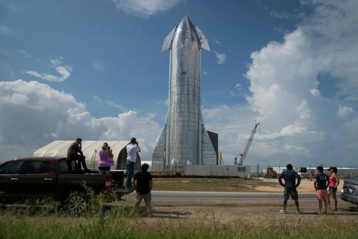 Space enthusiasts view a prototype of SpaceX's Starship spacecraft at the company's Texas launch facility in Boca Chica near Brownsville, Texas