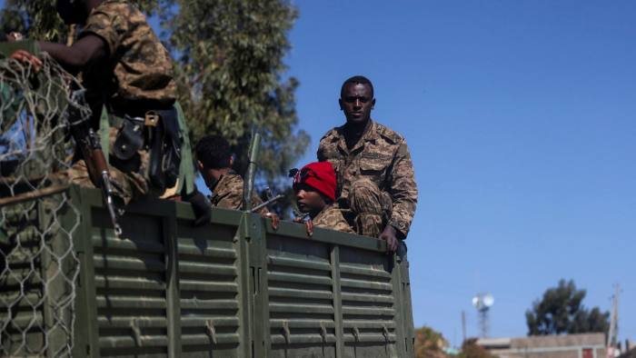 Ethiopian soldiers riding in a truck
