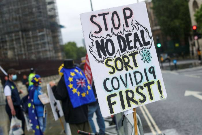 A placard near anti-Brexit protesters outside the Houses of Parliament in London in July. The transition period comes to an end in December