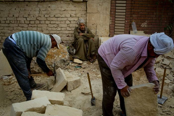 Workers in the 'City of the Dead' in Cairo. Egypt'semployment rate has fallen from 44.2%among working age Egyptians in 2010 to 35% in the second quarter of last year