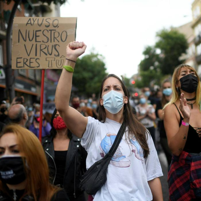 People attend a protest at the Vallecas neighborhood in Madrid, last weekend against the new restrictive measures
