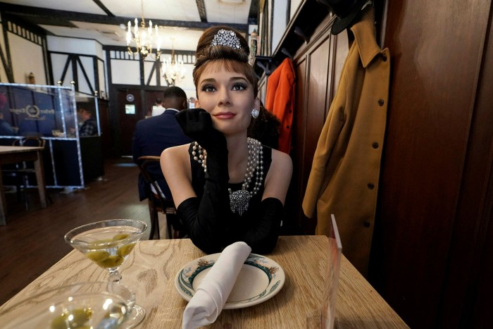 A Madame Tussauds wax figure of actress Audrey Hepburn, as Holly Golightly in the 1961 film Breakfast at Tiffany's, helps fill seats at the Peter Luger steak house in Brooklyn at the weekend