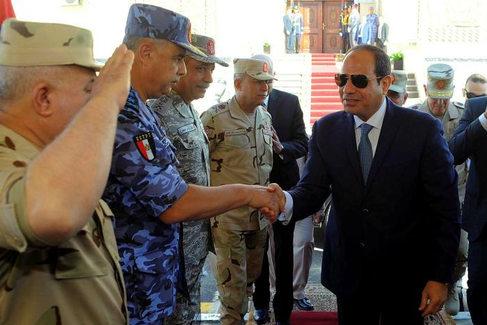 President Abdel Fattah al-Sisi meets army generals in Suez. Eight years after Sisi seized power, there is a growing fear the military's muscular economic expansion will prove irreversible
