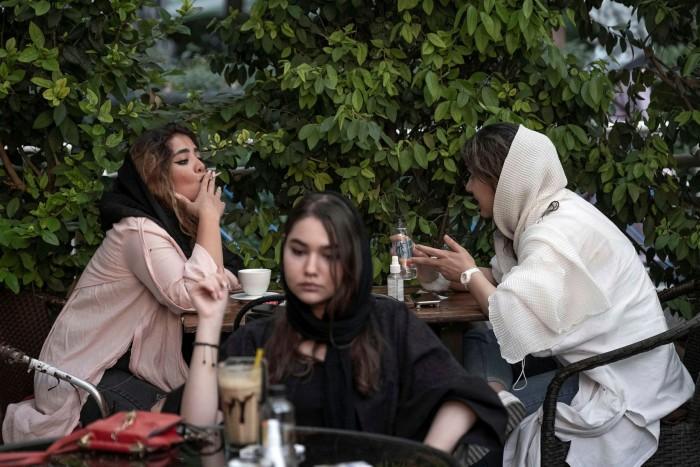 Iranian women sit at a cafe in the Ekbatan neighbourhood in western Tehran