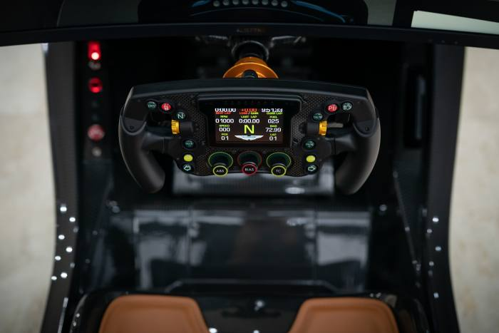 The F1-style steering wheel has paddle-shift gears