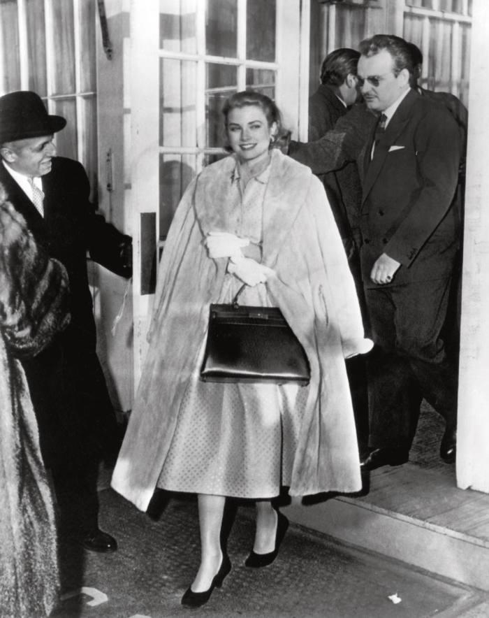 Grace Kelly with her Hermès Kelly bag, 1956