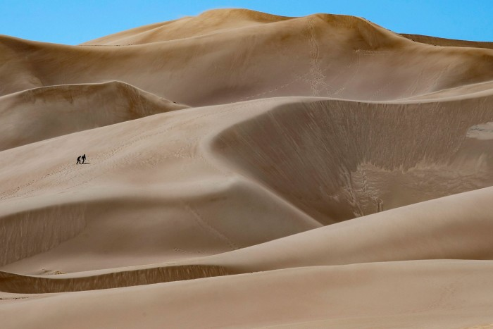 Visitors hike in Great Sand Dunes National Park near Mosca, Colorado, earlier this month