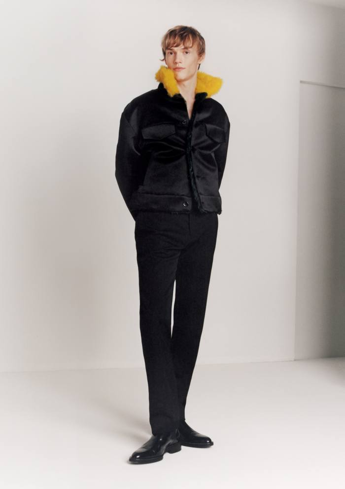 Kerkko Sariola wears Louis Vuitton satin and shearling military jacket, £2,897, and wool trousers, £267. Ami leather Chelsea boots, £380