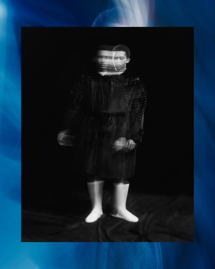 Front: Zuhair Abdulkadir wears Fendi perforated-macramé coat, POA, cotton knit top, £1,250, macramé knit socks, £110, andleather slippers, POA