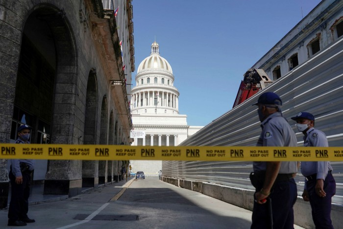 Police set up a road block near the National Capitol Building in Havana on Monday