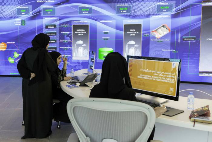 Employees work at the Panorama command centre at the Abu Dhabi National Oil Company. A person close to Sheikh Tahnoon says he is a huge believer in technology, which will help the UEA diversify its economy away from oil