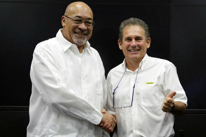 Suriname's former president Desi Bouterse with Rudolf Elias, director of Staatsolie, who says the country's relatively low production costs of very light, high-quality oil will give it an advantage 'for many years to come'