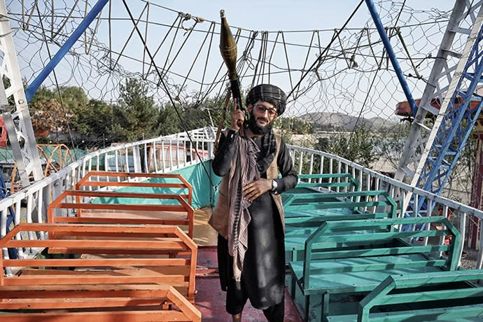 Taliban soldier carrying a rocket launcher on a pirate ship at Qargha Lake on the outskirts of Kabul