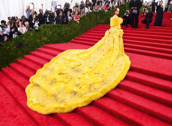 Rihanna arriving at the 2015 Met Gala in a Pei dress