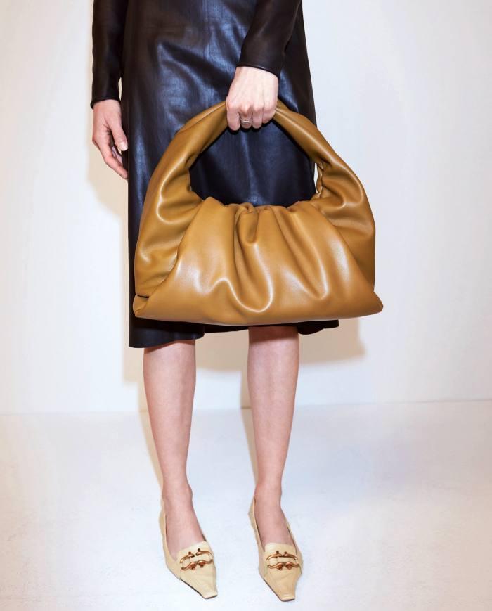 Bottega Veneta dress, £2,265, pumps, £595, and Pouch bag, £1,675